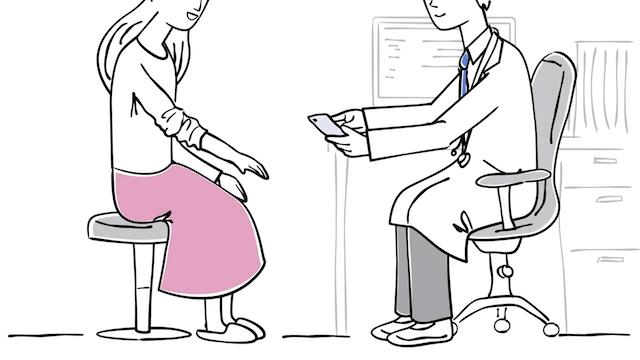 患部を撮影する医者